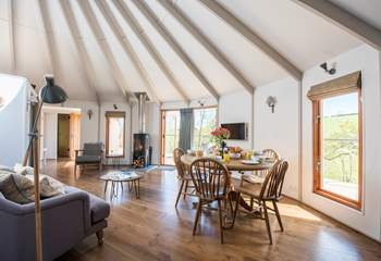 There is a huge 8 metre diameter living space in the large yurt and a triple bunk bedroom and en suite shower-room in the smaller yurt.