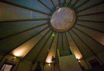 While away the hours star-gazing through the traditional yurt ceiling window.