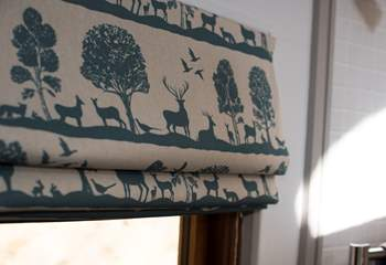 Beautiful fabrics have been used throughout.