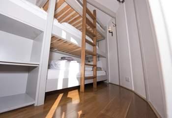 The triple bunk bedroom is in the smaller yurt.