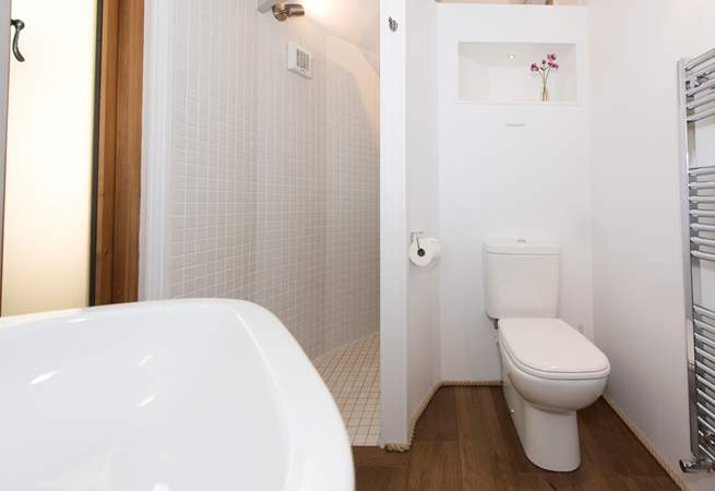 This shower-room includes a WC and wash-basin.