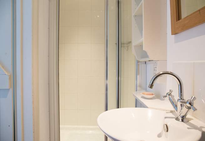 The shower-room has a large cubicle and heated towel rail for warm towels.