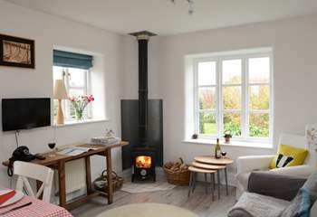The kitchen/dining/sitting-room is the perfect place to relax after a day of exploring, with its cosy wood-burner.