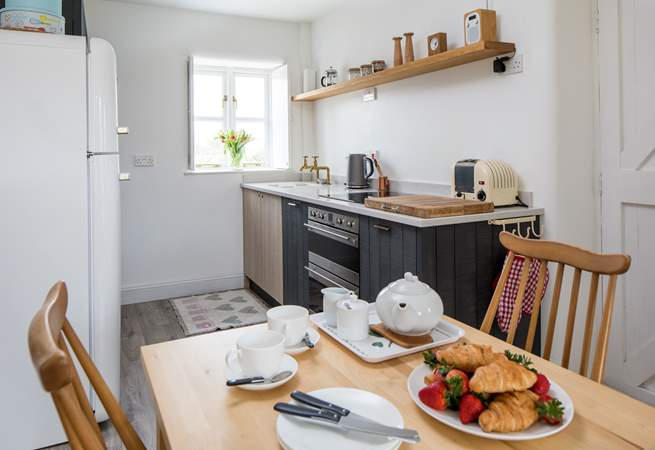 The compact kitchen is at one end of the open plan space.