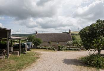 Looking down through the farmyard, the owners' house is at the bottom and the cottages to the right of the photo.