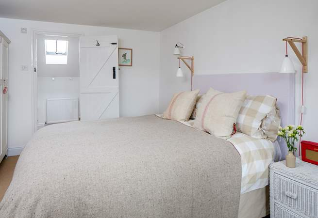 The master bedroom has a super comfy king-size double bed and an en suite bathroom.