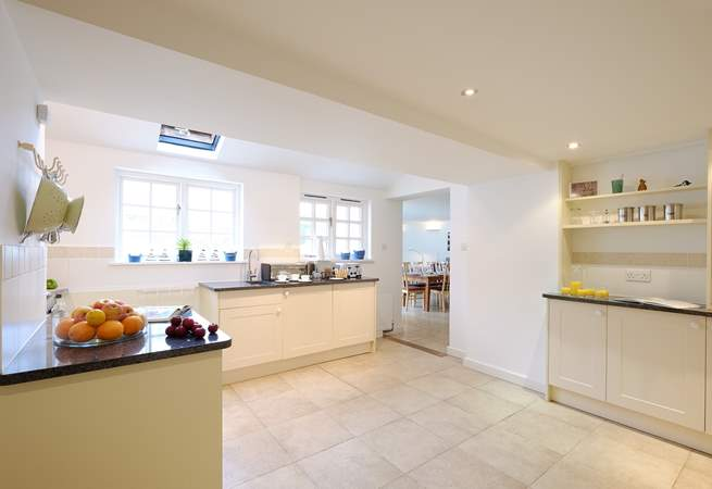 The spacious kitchen leads through into the open plan living/dining-room.