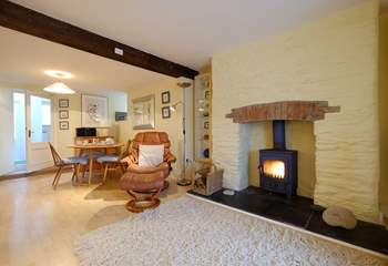 There is a warming wood-burner in the sitting/dining-room.