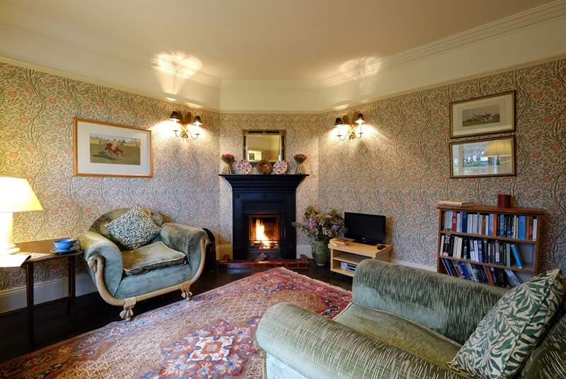 The sitting-room has an open fire.