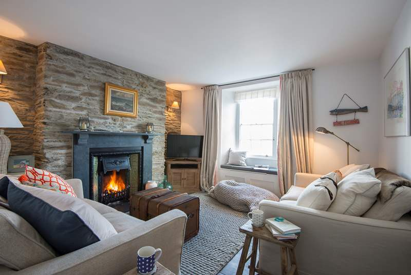 There are two sitting-rooms, this one has an open fire.