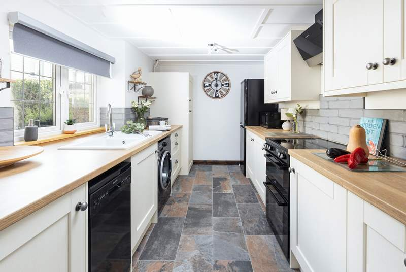 The stylish fully equipped kitchen has everything you need to rustle up a delicious meal.