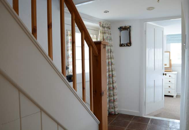 The ground floor dual-aspect bedroom is off the hallway, there is a small step down into the room.