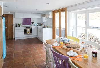 The open plan kitchen and dining-room is a very sociable space and has French doors onto a sheltered patio-area.