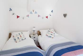 The seaside theme of this twin room will delight children.