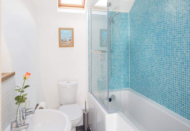 The family bathroom has a 'P' shaped bath and drench shower.