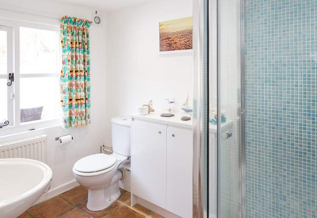 The ground floor bathroom has a double shower cubicle with drench shower and macerator WC.
