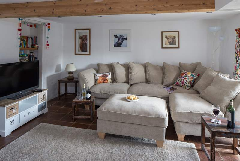 Step down into the comfy sitting-room, and if you are lucky enough to be tall, watch out for the low beam.