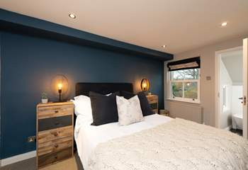 The second bedroom has a comfy double bed and en suite bathroom.