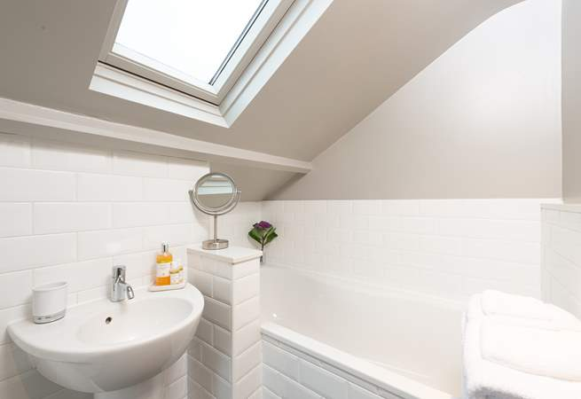 The en-suite bathroom has a hand held shower attachment, and REN products invite you to luxuriate in the bath.