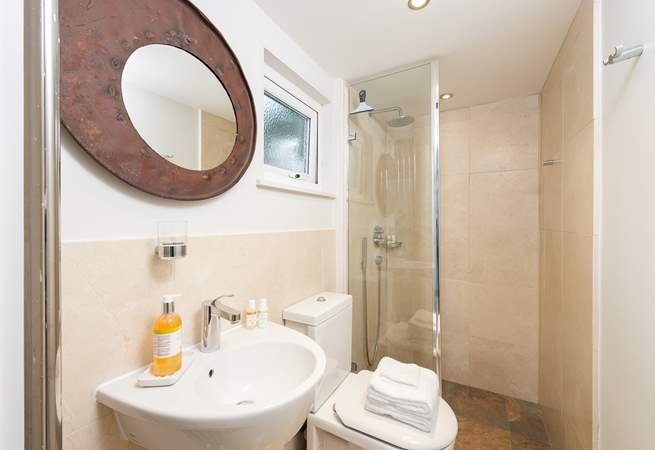 The ground floor shower-room has a large shower with drench head, perfect after a trip to the beach or a day spent sailing.