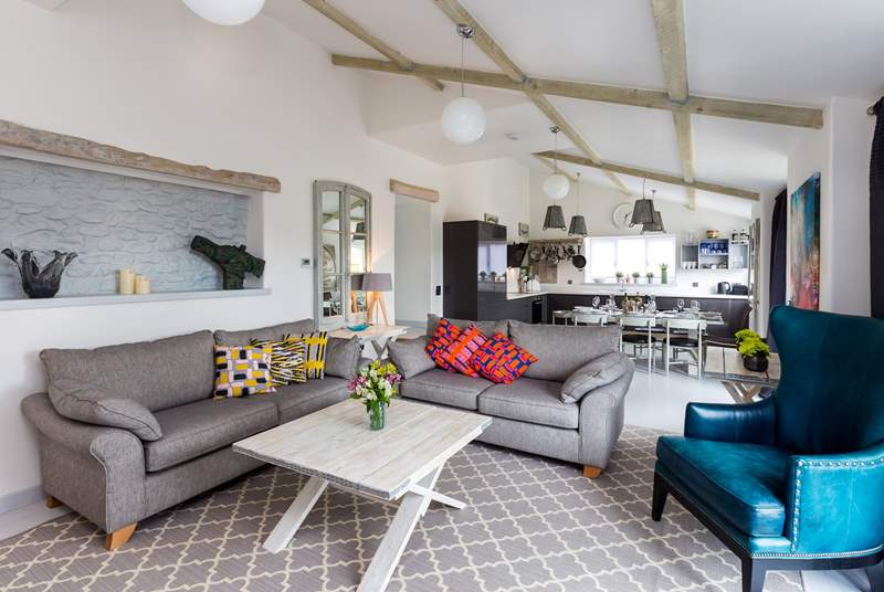 This gorgeous and luxurious barn conversion has a huge open plan living, cooking, dining-area with French windows that open out onto the terrace... and of course the hot tub !