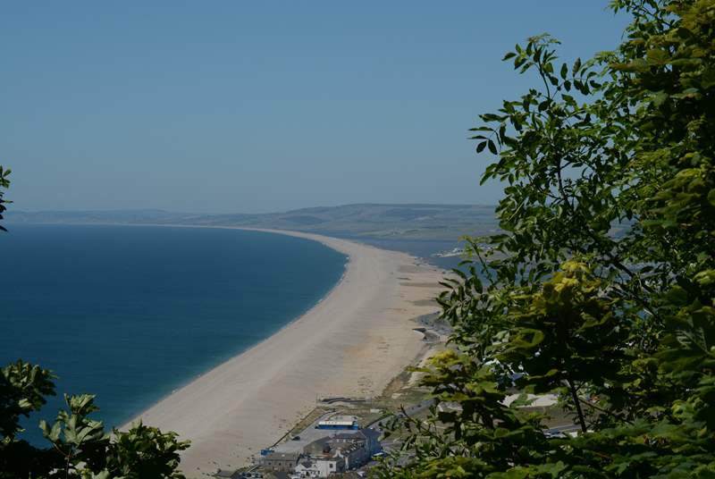 Chesil Beach is a spectacular shingle structure, viewed here leading from the Isle of Portland west towards Burton Bradstock.