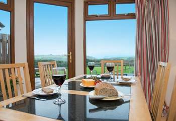 From the dining-area you can look out across the garden and take in the far reaching views of the sea.