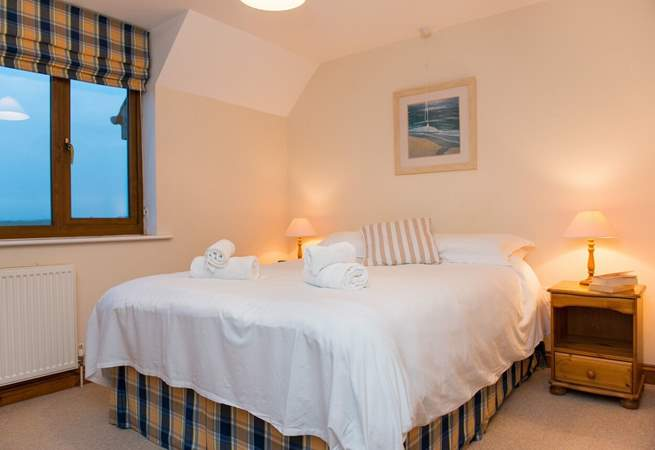 The master bedroom enjoys the views over the golf course and out to sea.
