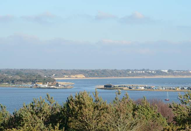 Taken from Hengistbury Head, this view shows the entrance to Christchurch harbour, Mudeford Quay to the left and Mudeford Sandbank to the right.