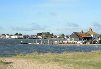 Looking across the mouth of Christchurch Harbour towards Mudeford Quay, ferry trips and adventure boat trips leave from the Quay.