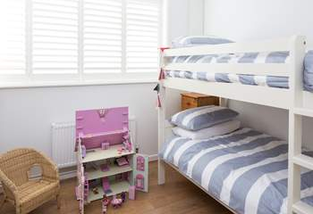 The cheerful children's room, bedroom 3, has 3ft bunk-beds and a beautiful doll's house to play with.