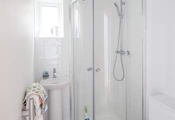 The en suite to the master bedroom is very compact with a drench head shower and petite hand basin.