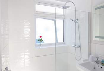 The family bathroom has a large shower with drench head.