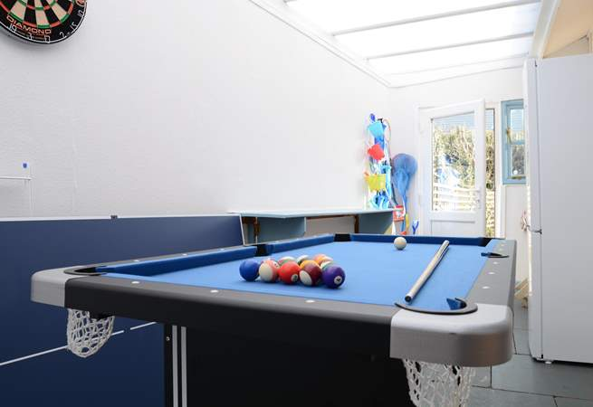The utility/games-room is not heated but provides lots of extra storage space and room for children to play. Maybe a family pool challenge?