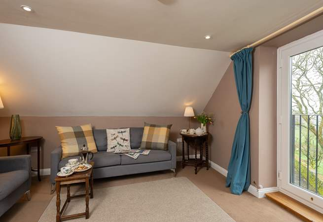 The first floor sitting-room makes the most of the fantastic valley views from the balcony.