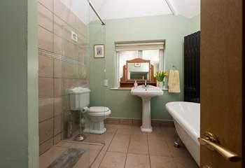 The ground floor bedroom has this en suite bathroom with separate shower cubicle.