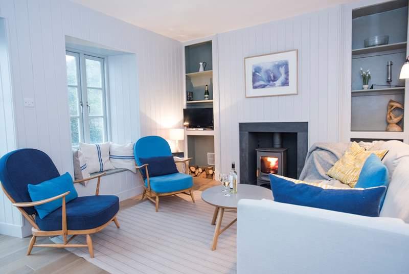 Retro furnishings suit the cottage wonderfully.