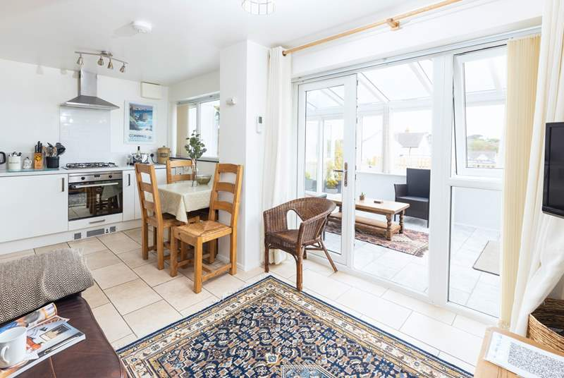 The light and airy living space leads out to the conservatory which in turn leads to the patio.