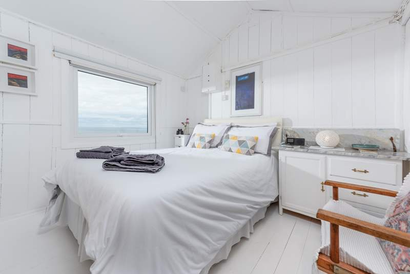 The master bedroom with its comfy king-size bed and a view straight out to sea.