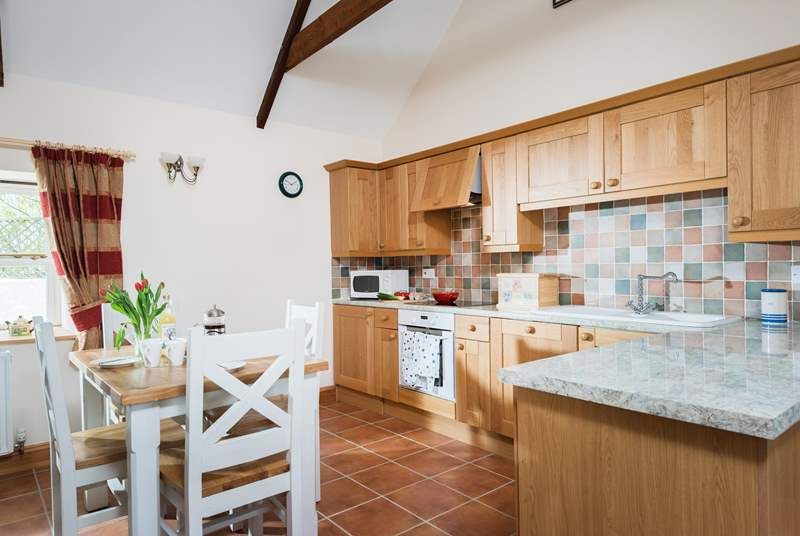 The well-equipped kitchen is on one side of the open plan living-room.