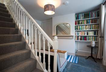 Stairs lead from the snug to the first floor.