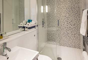 The family bathroom on the first floor has a double shower; plenty of space for sandy children.