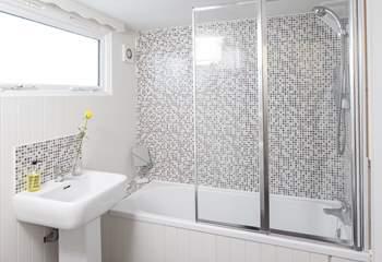 The ground floor bathroom has a large heated towel rail for toasty warm bathing.