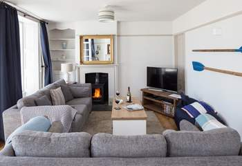 The stylish sitting-room has a Smart TV and BT Vision with sports package and DVD player.
