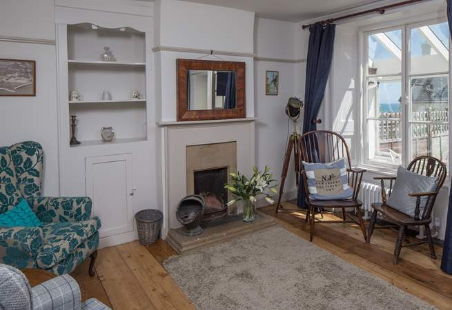 The sitting-room has both modern comfy chairs and those from its original working days.