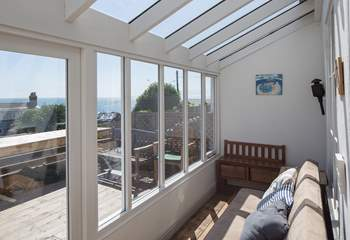 The fully glazed terrace is a great place to watch the changing seascape, whatever the weather.