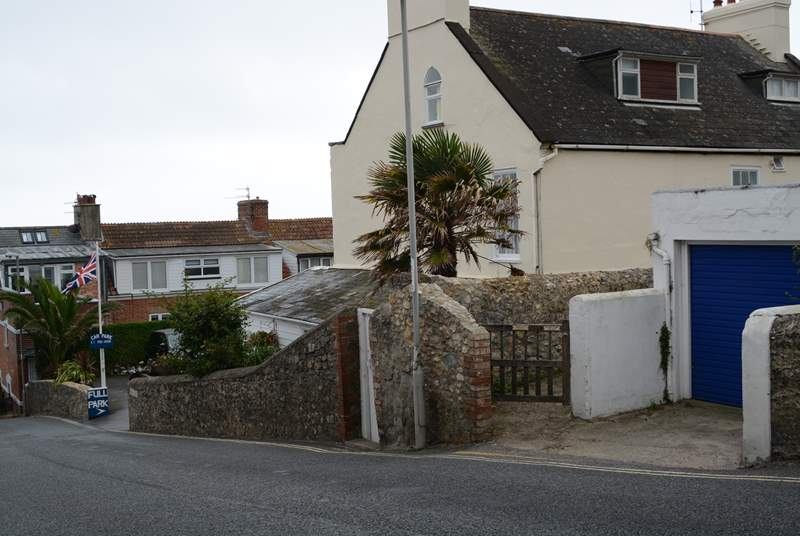 This is the view as you descend Cobb Road. The little gate is the access path to Cobb Cottage and the parking is just below. Turn right into the car park and the allocated space is at the end on the right.