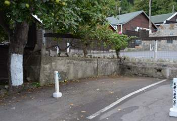 This is the marked parking space for Cobb Cottage, the space beside the tree marked with white paint. The cottage is just above accessed via a footpath.