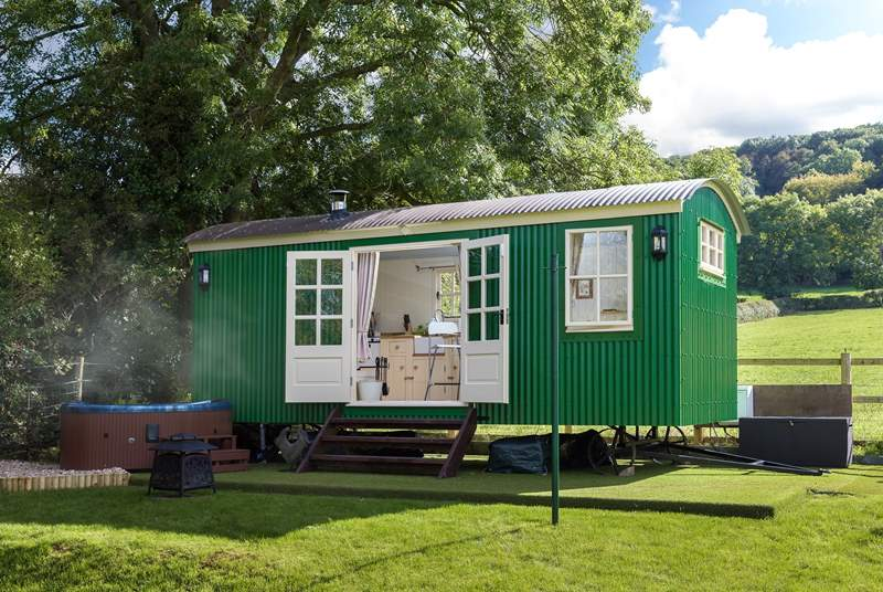 This gorgeous shepherd's hut is in a private location, sheltered by the trees behind it and with the luxury of a wonderful hot tub. There are fields all around.