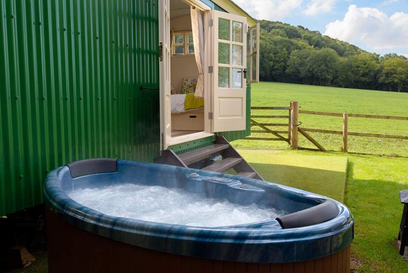 You can soak in the hot tub with countryside views - not overlooked at all.